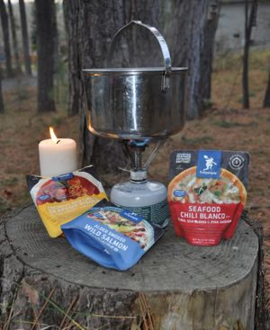 A camping stove and heat-in-pouch food makes a quick meal in the field or in an urban emergency.   (Rich Landers / The Spokesman-Review)