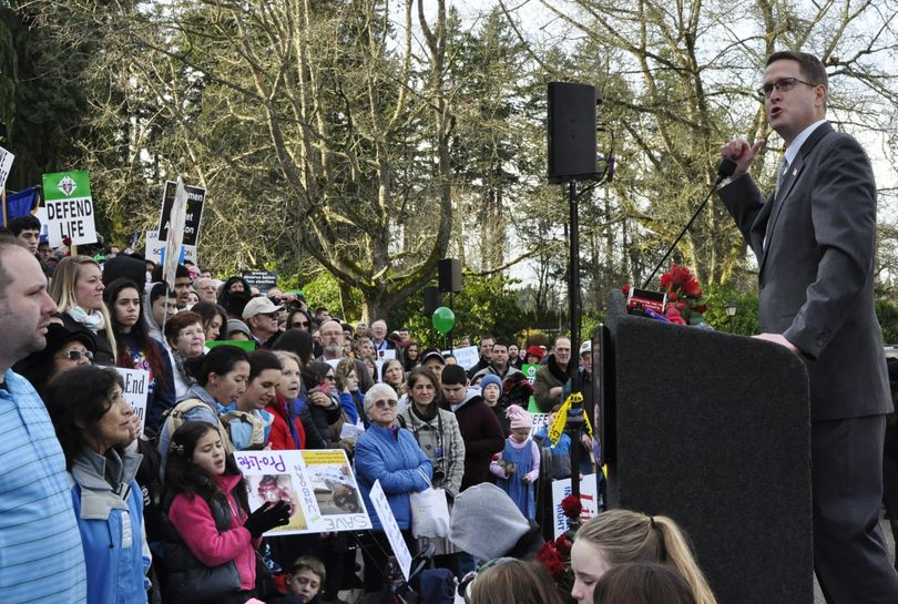 OLYMPIA -- Rep. Matt Shea, R-Spokane Valley, tells members of the March for Life on the steps of the state Capitol to continue the fight against legalized abortion. (Jim Camden)