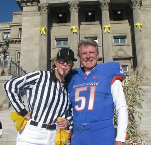 First Lady Lori Otter, left, dressed as a referee, and Gov. Butch Otter, right, dressed as a Boise State football player, host their second annual kids' trick-or-treat on the state Capitol steps on Monday, where they handed out candy and toothbrushes to trick-or-treaters. (courtesy)