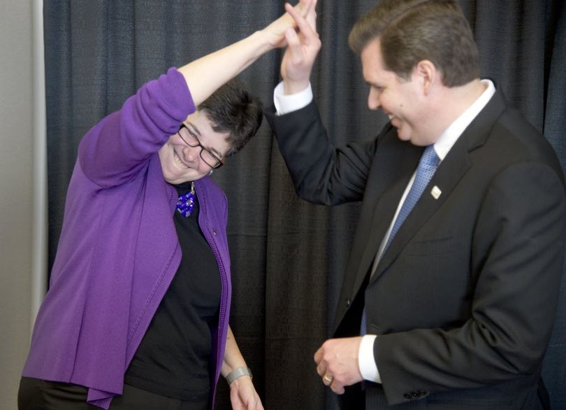 University of Washington President Ana Marie Cauce, left, and Gonzaga University President Thayne McCulloh share a high five after the announcement that Gonzaga University would host UW medical students on campus, starting in the fall of 2016. The announcement was Wednesday, Feb. 24, 2016 at Gonzaga University.  (Jesse Tinsley)