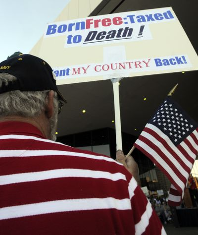Outside the Spokane Opera House Thursday, Don Stone attends a Constitution Day rally sponsored by the Tea Party organization of Spokane. (Colin Mulvany / The Spokesman-Review)