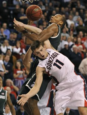 Gonzaga's David Stockton is roughed up in the second half against Michigan State's Adreian Payne. (Dan Pelle)