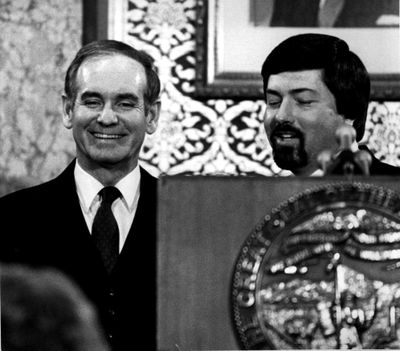 In a Jan. 12, 1982 file photo, Iowa Governor Robert Ray, left, enjoys a light moment at the Statehouse podium with Lt. Governor Terry Branstad after the Condition of the State speech. (BILL DANIEL / Associated Press)