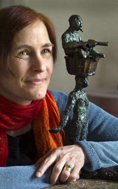 """Spokane artist Ildikó Kalapács, whose bronze sculpture Bearing is slated to be installed in Kendall Yards's Sunset Park in 2021, continues her efforts around the issues facing refugees. Her latest exhibit, """"Unwanted Journeys,"""" features drawings and sculpture by Kalapács, as well as stories by refugees now living in the Spokane area. (Dan Pelle / The Spokesman-Review)"""