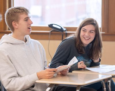 Miles Heath, left, and Bri Dashiell take part in a class discussion about probability in a statistics class Thursday, Nov. 13, 2019, at Lewis and Clark High School in Spokane. In the 2020 U.S. News and World Report's top 100 high schools in the United States, LC is ranked 27th out of 17,790 public high schools. (Jesse Tinsley / The Spokesman-Review)