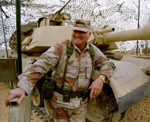 In this Jan. 12, 1991 file photo, Gen. H. Norman Schwarzkopf stands at ease with his tank troops during Operation Desert Storm in Saudi Arabia.   (AP Photo)