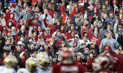 WSU fans raise their voices during second-overtime play of the 2008 Apple Cup game at Martin Stadium in Pullman.  (File / The Spokesman-Review)