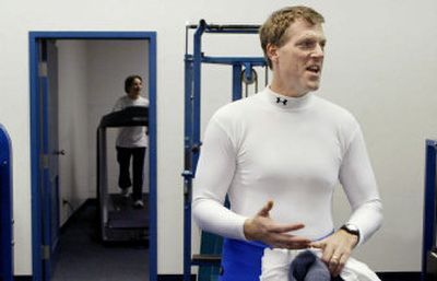 Jim Brown, 44, discusses his workout routine before starting his cardiovascular exercises at the fitness facility of Worthington Industries in Columbus, Ohio. . Brown, a information technology worker, receives health insurance incentives from the steel processing company for exercising and monitoring his health.   (Associated Press / The Spokesman-Review)