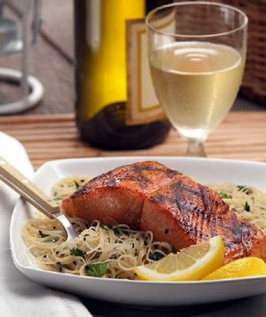 Honey-Soy Grilled Salmon with Cilantro Noodles pairs grilled salmon with a light Asian noodle salad. The recipe takes only about 30 minutes to make.   (Associated Press / The Spokesman-Review)