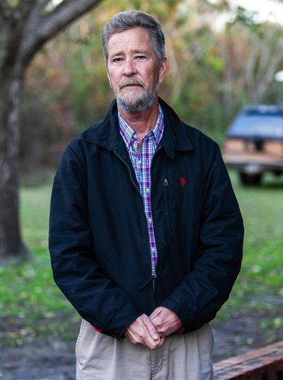 In this Dec. 5, 2018, file photo, Leslie McCrae Dowless Jr., poses for a portrait outside his home in Bladenboro, N.C. State investigators have described Dowless as a person of interest in their probe into 2018 voting irregularities involving absentee ballots. (Travis Long / Associated Press)
