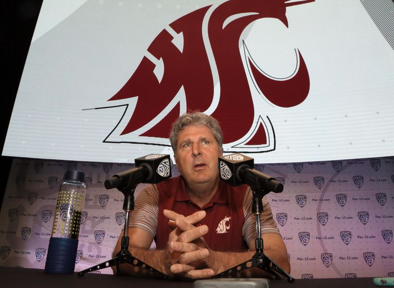 Washington State coach Mike Leach speaks at the Pac-12 NCAA college football media day in Los Angeles on July 14. On Tuesday, Leach accused the media and the local police of unfairly targeting WSU football players. (Reed Saxon / Associated Press)