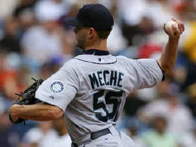 Seattle Mariners starting pitcher Gil Meche throws during the first inning against the Chicago White Sox.  (Associated Press / The Spokesman-Review)