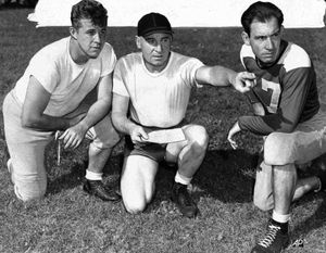 Coach Ray Flaherty of the New York football Yankees holds the attention of Frankie Sinkwich, left and Ace Parker. Flaherty, a Hall of Fame end who played  on the New York Giants' 1934 NFL championship team and coached the  Washington Redskins to titles in 1937 and 1942. Flaherty started his football career at Gonzaga High. (The Spokesman-Review archives)