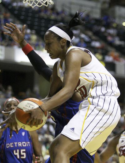 Briann January grabs a rebound in last Saturday's win in which she had a WNBA career-high of 17 points.  (Associated Press / The Spokesman-Review)