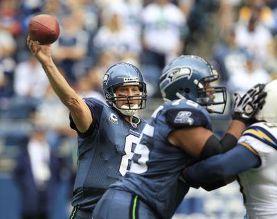 Seattle lineman Sean Locklear, right, and quarterback Matt Hasselbeck have struggled on offense this season. (Associated Press)