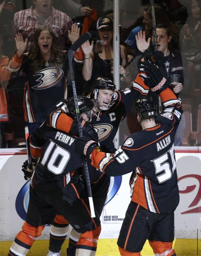 Despite taking a slap shot to the face in Game 1, Anaheim's Getzlaf (center) returned in Game 2 and tallied one goal, one assist. (Associated Press)