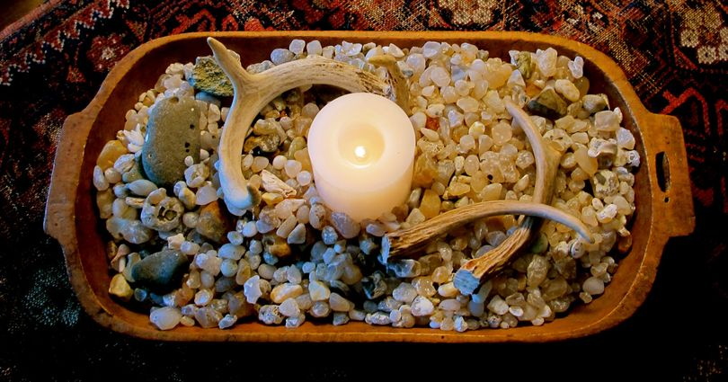 An antique dough bowl, filled with natural objects such as stones and antlers, makes an pretty setting for a candle. (Cheryl-Anne Millsap / Photo by Cheryl-Anne Millsap)