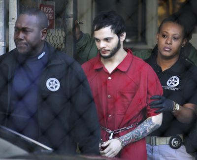 Esteban Santiago, center, is led from the Broward County jail for an arraignment in federal court Jan. 30, 2017, in Fort Lauderdale, Fla.Santiago, a 28-year-old Alaska man, pled guilty in the January 2017 Florida airport shooting that left five people dead and six wounded. (Lynne Sladky / Associated Press)