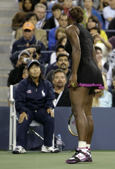 Serena Williams argues with a line judge over a foot fault call during her match against Kim Clijsters. (Associated Press / The Spokesman-Review)