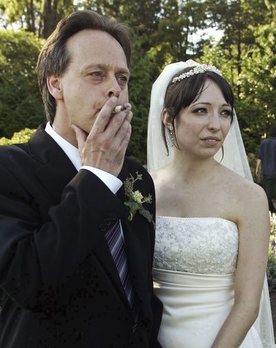 Marc Emery, Canada's so-called Prince of Pot, smokes a marijuana cigarette at his marriage to his wife, Jodie, in Vancouver, B.C., on July 23, 2006.  (Associated Press / The Spokesman-Review)