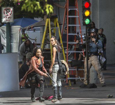 Z Nation actors Kellita Smith, as Warren, left, and Sydney Viengluang, as Sun Mei, shoot a scene on Wall Street, Aug. 26, 2016, in downtown Spokane. (Dan Pelle / The Spokesman-Review)
