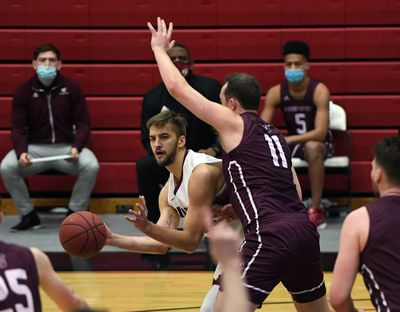 Whitworth Chewy Zevenbergen (40) looks to pass as Puget Sound forward Grant Erickson (11) defends during the first half of a college basketball game, Friday, Feb. 12, 2021, at Whitworth University.  (Colin Mulvany/THE SPOKESMAN-REVIEW)