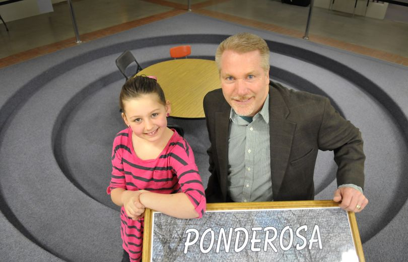 Lucy Tivis, 8, and Jerrol Olson, principal of Ponderosa Elementary in Spokane Valley pose for a photo at the school Wednesday. Lucy nominated Olson to be Principal on Parade, selected by the Friendly Sons of St. Patrick. He won and, along with Lucy, will ride in the St. Patrick's Day parade today in Spokane. (Jesse Tinsley)