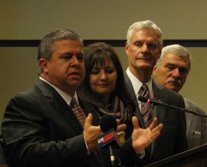 Idaho schools chief Tom Luna, left, announces that he won't seek re-election. Also pictured are Luna's wife Cindy, Senate President Pro-Tem Brent Hill, and Senate Education Chairman John Goedde. (Betsy Russell)