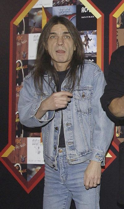 A March 3, 2003 file photo of AC/DC co-founder and guitarist Malcolm Young at an event in London. (Yui Mok / Associated Press)