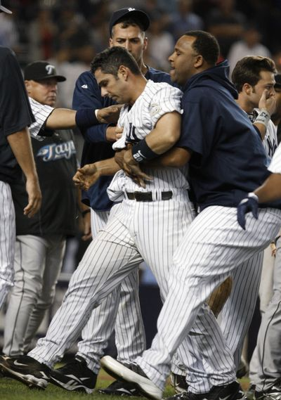 Jorge Posada was in the center of Tuesday's scuffle.  (Associated Press / The Spokesman-Review)