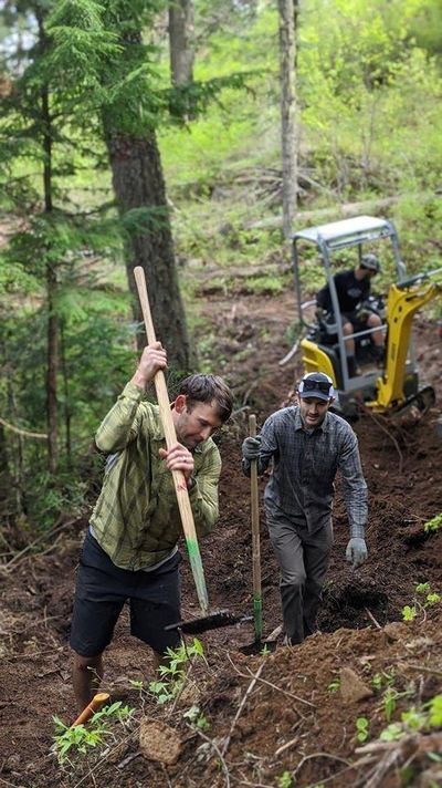 Volunteers work on the Silicate Slide, a mountain bike-specific downhill flow trail in the Mica Peak conservation area. (Evergreen East / COURTESY)