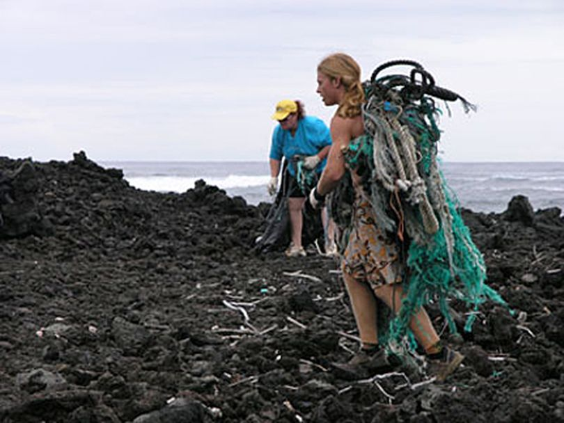 Volunteers pick up marine debris from a Washington coast beach. (NOAA)