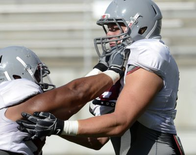 """Senior Travis Long, right, played defensive end the past three seasons but is now a """"buck"""" linebacker. (Dan Pelle)"""