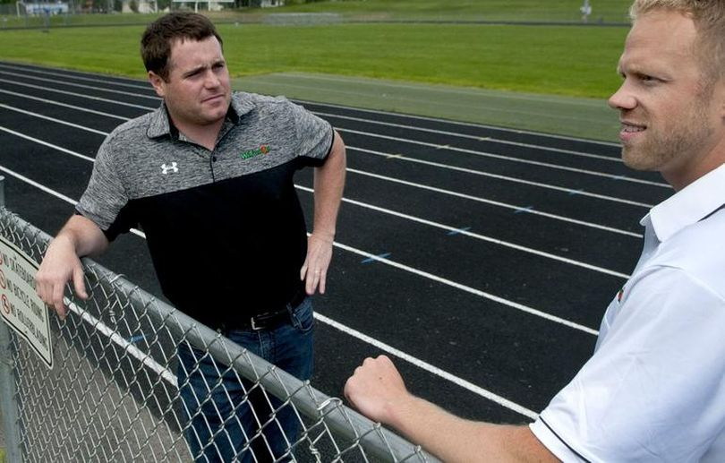 Alex Hamill, left and Paul Landers run a company that raises money for high school sports. (Kathy Plonka / The Spokesman-Review)
