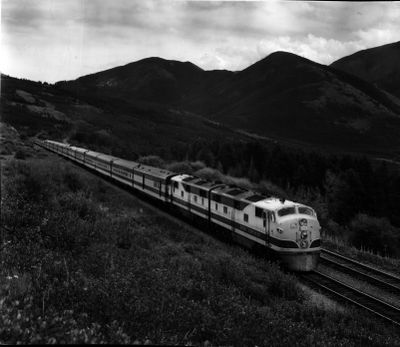 The streamlined Empire Builder of Great Northern Railway travels westward through the Rocky Mountains in Montana in this 1971 photo.  (The Spokesman-Review photo archive)