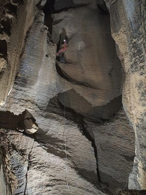 Beth Cortright rappelling down Birthday Pit in Tears of the Turtle Cave. (James Hunter / Courtesy)