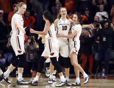 From left to right, Oregon State's Joanna Grymek, Taya Corosdale, Katie McWilliams and Aleah Goodman (1) celebrate their win over Boise State in a first-round game of the NCAA women's college basketball tournament in Corvallis, Ore., Saturday, March 23, 2019. (Amanda Loman / AP)