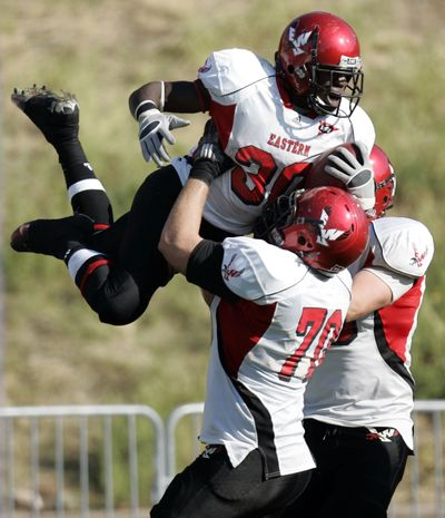 EWU running back Darriell Beaumonte celebrates his touchdown with lineman Steven Forgette (70).  (Nick Short)