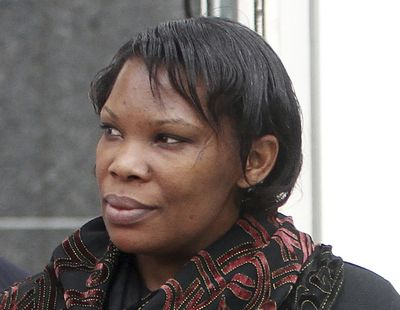 In this April 12, 2012 photo, Beatrice Munyenyezi leaves the Federal Court in Concord, N.H. Munyenyezi, who served a 10-year sentence in federal prison for lying about her role in the 1994 Rwanda genocide to obtain U.S. citizenship and lost her bid for a new trial has been deported to Rwanda, her lawyer said Saturday, April 17, 2021. Munyenyezi was convicted and sentenced in 2013 in New Hampshire.  (Jim Cole)