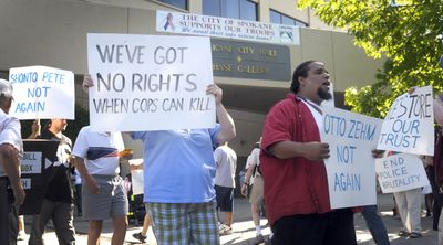 Protesters march Thursday in front of Spokane City Hall to highlight concerns over police actions and oversight.  (CHRISTOPHER ANDERSON / The Spokesman-Review)