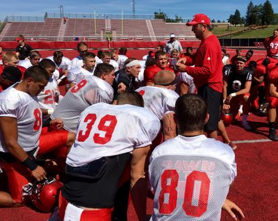 Eastern Washington coach Beau Baldwin addresses his players after Saturday's scrimmage. (Jim  Allen / The Spokesman-Review)
