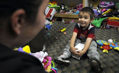 Comrad Hawthorn, 3, finds what he was looking for at St. Vincent DePaul Thrift store on Tuesday. Comrad and his mom, Tiffany Carson, are regulars at the store in Coeur d'Alene.  (Kathy Plonka / The Spokesman-Review)