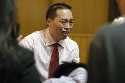 Chai Soua Vang testifies at his murder trial Thursday in Hayward, Wis. Vang is charged with six counts of first-degree murder and three counts of attempted murder in the Nov. 21, 2004, shootings in isolated woods in Wisconsin.  (Associated Press / The Spokesman-Review)