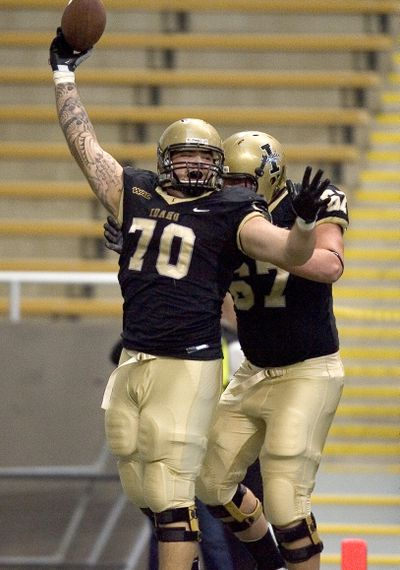 Idaho offensive lineman Matt Cleveland (70) celebrates with teammate Tyrone Novikoff after running in a fumble by Princeton McCarty for (Associated Press)