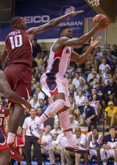 Gonzaga guard Gary Bell, Jr., right, gets by Arkansas forward Bobby Portis (10)for two pointsin the second half of an NCAA college basketball game at the Maui Invitational on Wednesday.  (Associated Press)