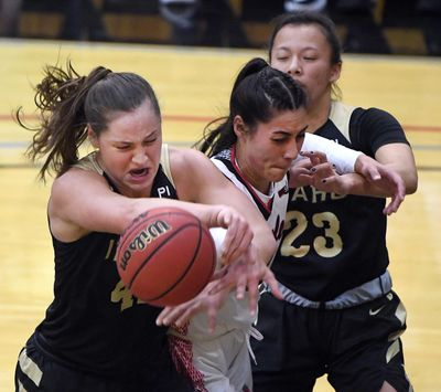 Idaho forward Natalie Klinker, left wrestles the ball away from Eastern Washington center Bella Cravens during the first half of a college basketball game, Thursday, Feb. 13, 2020, in Cheney, Wash. (Colin Mulvany / The Spokesman-Review)
