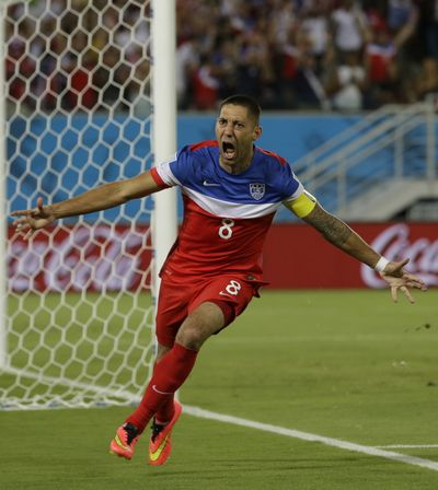 United States' Clint Dempsey celebrates after scoring the opening goal during the group G World Cup soccer match between Ghana and the United States at the Arena das Dunas in Natal, Brazil, Monday. The U.S. won, 2-1. (Associated Press)