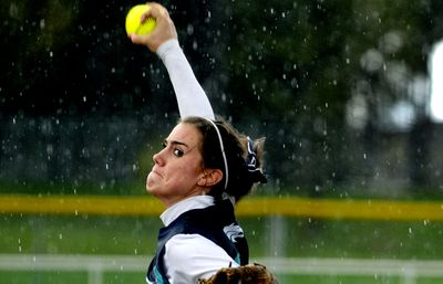 Lela Work delivers a pitch in the rain during Lake City's game against Borah on Thursday at Ramsey Park in Coeur d' Alene.  (Kathy Plonka / The Spokesman-Review)