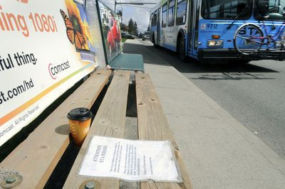 A bus stop bench on 29th Avenue near Ray Street has a sheet attached to it informing users the bench will be removed soon. The message was posted by Sunset Outdoor Advertising.  (Dan Pelle / The Spokesman-Review)