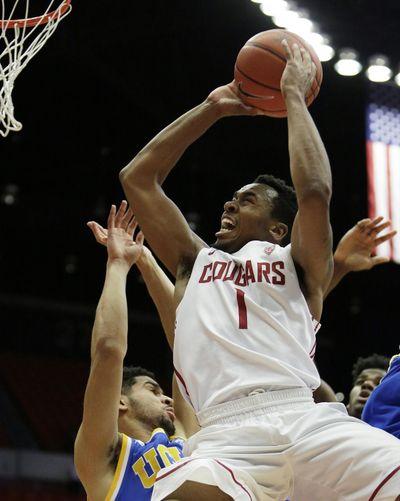 Washington State's Renard Suggs shoots over UCLA's Noah Allen. (Young Kwak / Fr159675 Ap)